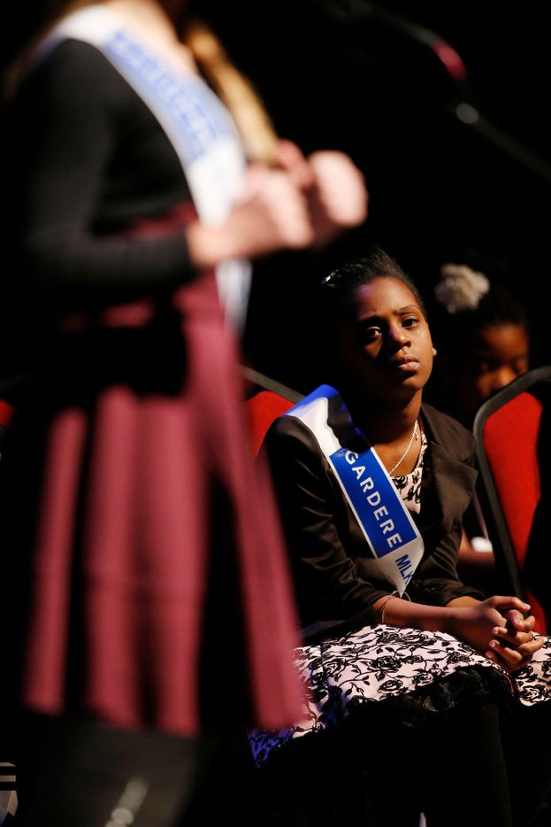 Sierra Jones, a fifth grader at Charles Rice Learning Center, listens to fifth-grader Ashley Patterson give her speech during the 25th Annual Gardere MLK Jr. Oratory Competition at the Majestic Theatre in Dallas on Friday, Jan. 13, 2017. (Rose Baca/The Dallas Morning News)