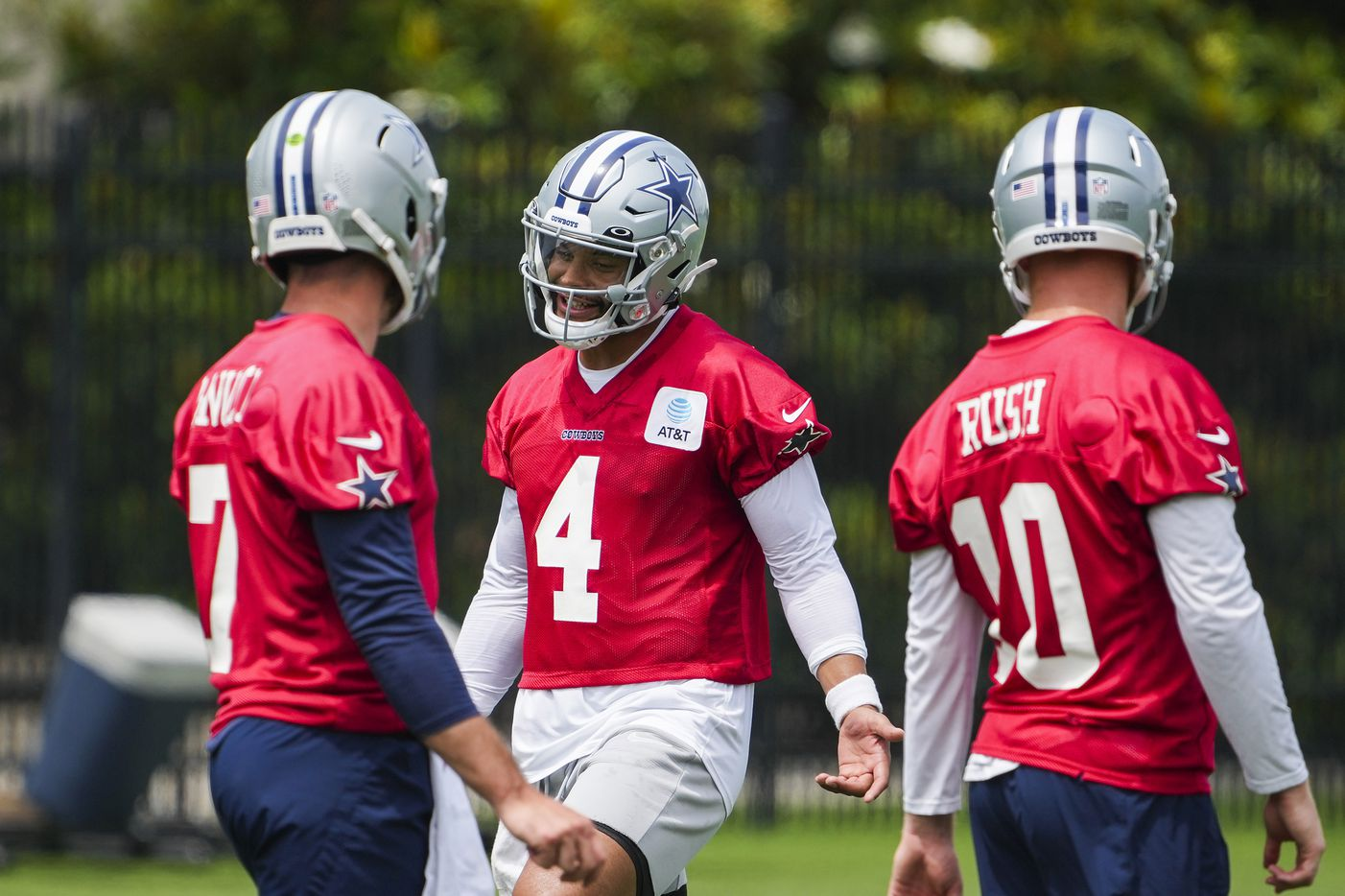 Dallas Cowboys quarterback Dak Prescott (4) laughs with fellow quarterbacks Ben DiNucci (7) and Cooper Rush (10) during a minicamp practice at The Star on Tuesday, June 8, 2021, in Frisco. (Smiley N. Pool/The Dallas Morning News)