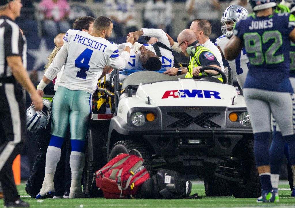 Dallas Cowboys wide receiver Allen Hurns (17) gets a handshake from quarterback Dak Prescott (4) as he is carted off the field after an injury during the first quarter of an NFL playoff game between the Dallas Cowboys and the Seattle Seahawks on Saturday, January 5, 2019 at AT&T Stadium in Arlington, Texas. (Ashley Landis/The Dallas Morning News)