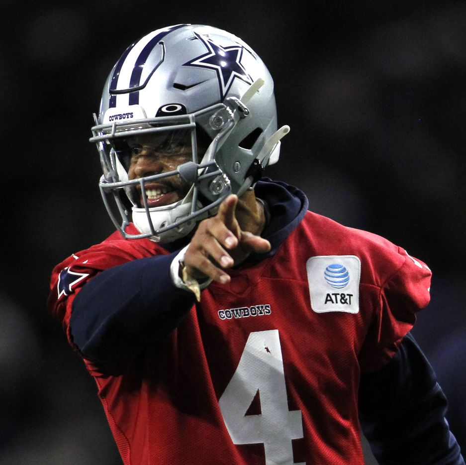 Dallas Cowboys quarterback Dak Prescott (4) directs a teammate during a practice session. The Cowboys conducted their final public football practice session of training camp inside The Star at the Ford Center in Frisco on August 28, 2021. (Steve Hamm/ Special Contributor)