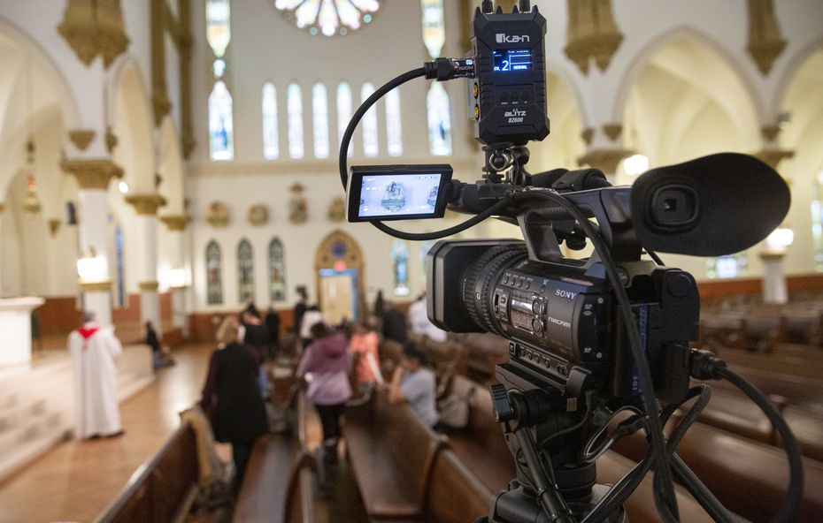 The ritual reading of the Stations of the Cross is conducted by Rev. Stephen Bierschenk at Dallas' Cathedral Shrine of the Virgin of Guadalupe on March 13, 2020 in Dallas.  The reading was filmed for online viewing as the Diocese of Dallas shifts services online in response to coronavirus concerns.