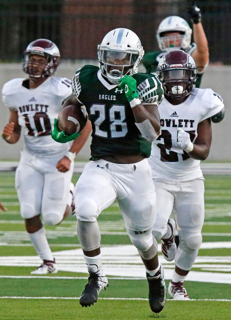 Prosper High School running back JT Lane (28) outruns Rowlett High School defensive backs Xavier Wills (10) and Timothy Armstrong (27) to score a touchdown during the first half as Prosper High School hosted Rowlett High School in a non-district football game at Children's Health Stadium in Prosper on Friday, August 30, 2019. (Stewart F. House/Special Contributor)