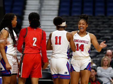 Duncanville guard Kiyara Howard-Garza #14 celebrates with Duncanville guard Tristen Taylor #11 after causing a turnover in a 6A semifinal Duncanville defeated Converse Judson 45-36 on Friday, March 6, 2020 at the Alamodome. (Ron Cortes/Special Contributor)