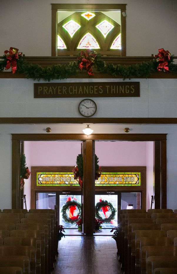 "The sign ""Prayer Changes Things,"" which used to hang near the baptistery behind the pulpit, now hangs near the entrance inside Junius Heights Baptist Church."