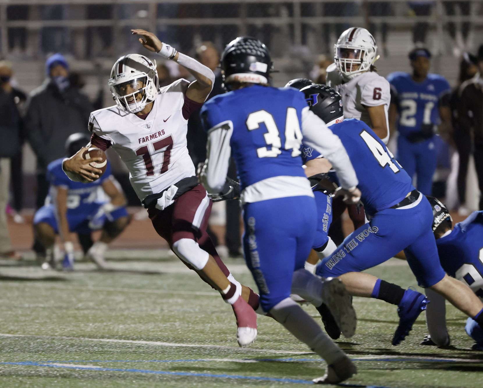 Lewisville quarterback  Taylen Green (17) tries to get past Hebron defenders Evan Hellwig and Carson Dean (44) during their District 6-6A high school football game on Dec. 4, 2020. (Michael Ainsworth/Special Contributor)