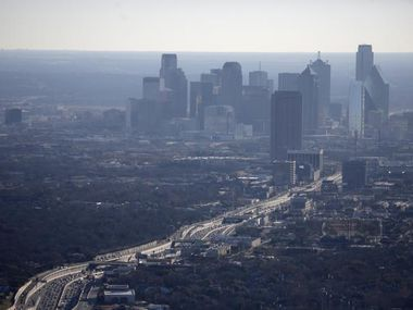 With Dallas' booming population and oft-clogged freeways — North Central Expressway looking south toward downtown is shown here — hazy air isn't uncommon. Air quality is among the many things Dallas officials hope their new climate plan will address.