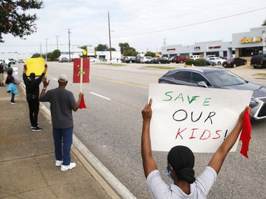 Nadette Brewster (right) of DeSoto shows her support for Dr. D'Andre Weaver as members of the community rally together in front of the DeSoto ISD administration building in DeSoto, Texas on Saturday, September 5, 2020. Disputes over administration of the school district were among the more recent issues to trouble DeSoto ISD.