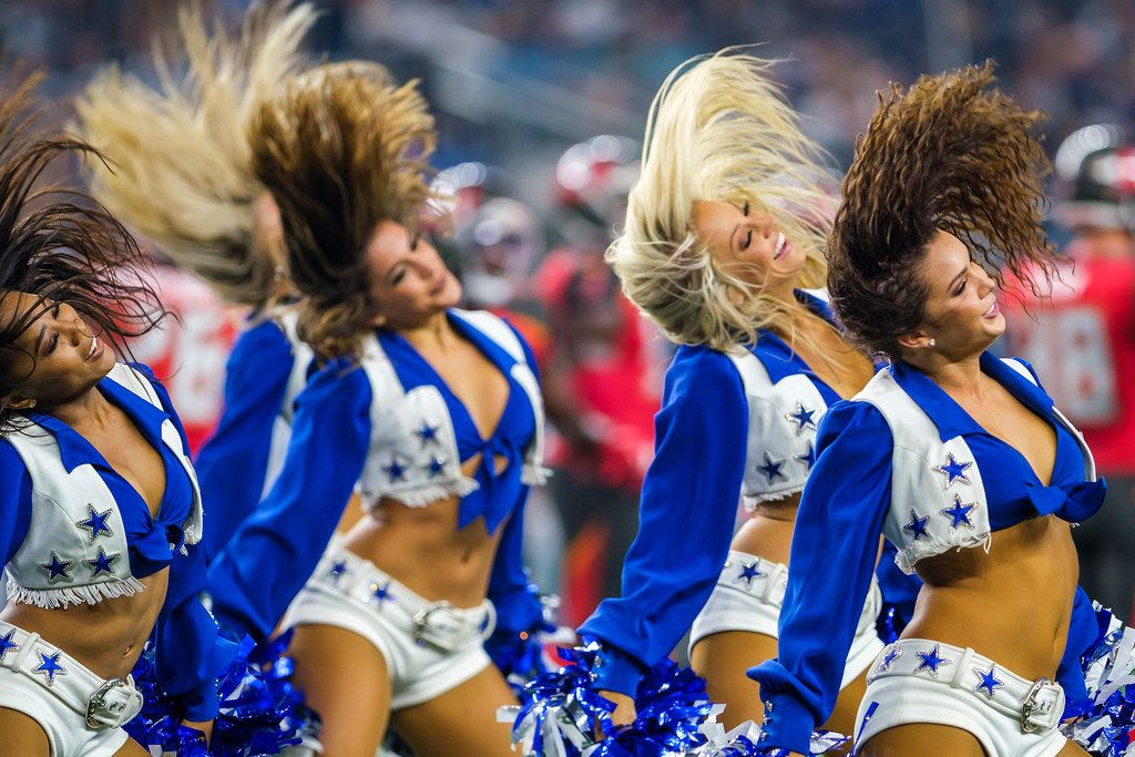Dallas Cowboys cheerleaders perform during a timeout in the first half of the team's Aug. 29 NFL preseason football game against the Tampa Bay Buccaneers at AT&T Stadium.