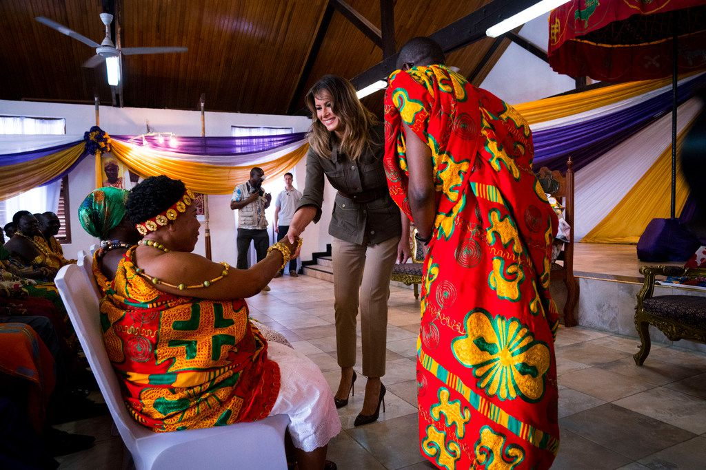 First lady Melania Trump greets dignitaries during a welcome ceremony in the Obama Hall, named in honor of former President Barack Obama, at Emintsimadze Palace in Cape Coast, Ghana, on Oct. 3, 2018. During the ceremony, the first lady asked a regional tribal chief for official permission to visit the nearby Cape Coast Castle, one of dozens of hubs of the transatlantic slave trade.