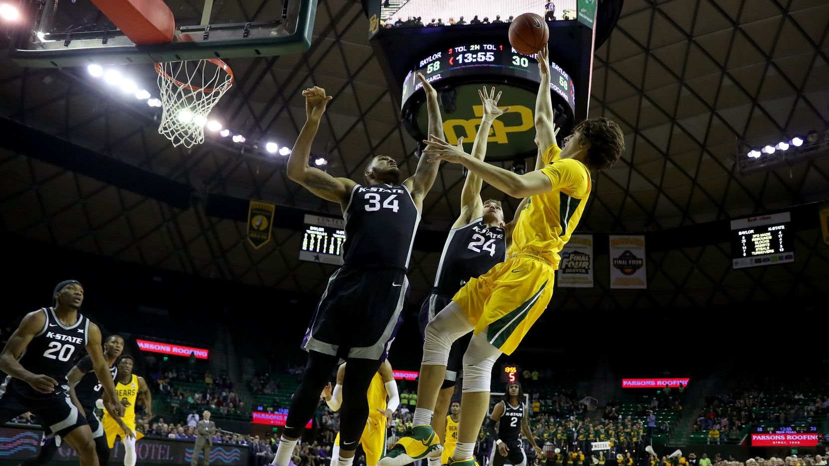 WACO, TEXAS - FEBRUARY 25: Matthew Mayer #24 of the Baylor Bears shoots the ball against Levi Stockard III #34 of the Kansas State Wildcats and Pierson McAtee #24 of the Kansas State Wildcats in the second half of a NCAA basketball game at Ferrell Center on February 25, 2020 in Waco, Texas.