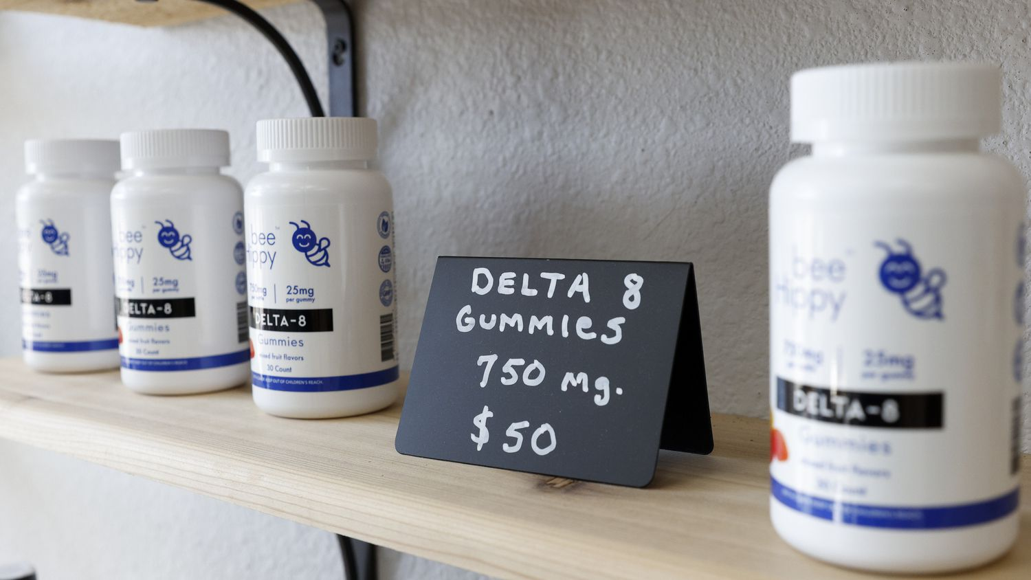 """Delta-8 THC products sit for sale at Bee Hippy Hemp Dispensary in downtown Garland. Delta-8 is a less-potent alternative to the delta-9 product known as """"marijuana."""""""