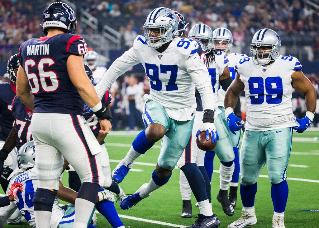 Dallas Cowboys defensive end Taco Charlton (97) celebrates after recovering a fumble after he knocked the ball loose while sacking Houston Texans quarterback Deshaun Watson (4) during the first quarter of an NFL game between the Dallas Cowboys and the Houston Texans on Saturday, August 24, 2019 at AT&T Stadium in Arlington. (Ashley Landis/The Dallas Morning News)
