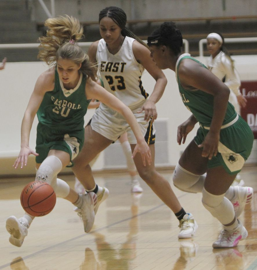 Southlake Carroll guard Camryn Tade (20) cases a loose ball as teammate Jordyn Sowell (33), right and Plano east guard Donavia Hall (23) move in during first half action. Plano East won 56-42 to advance. The two teams played their Class 6A regional semifinal girls playoff basketball game at Loos Field House in Addison on February 27, 2021. (Steve Hamm/ Special Contributor)