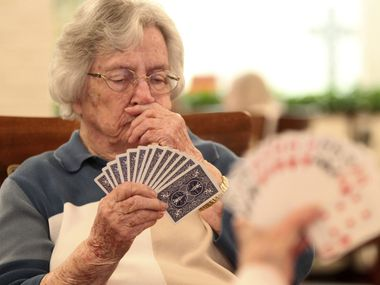 In this January file photo, Jo Turner, a resident at Traceway Retirement Community, contemplates her hand as she plays a game of bridge in Tupelo, Miss. (Adam Robison/The Northeast Mississippi Daily Journal via AP)