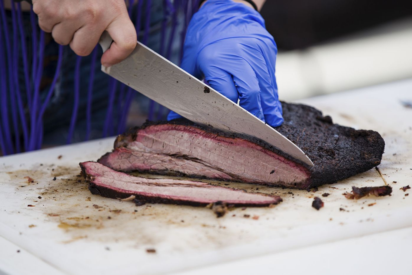 A student slices beef brisket at the State of Texas High School Barbecue Cook-off in Burnet.