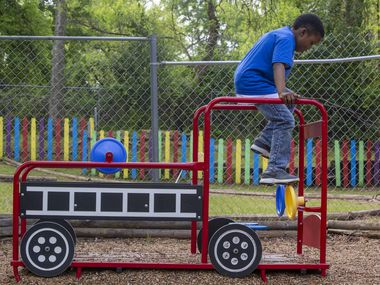 J'airus Randall, 8, plays on a fire truck toy during outdoor playtime at A Heart To Give Early Childhood Center in DeSoto, Texas, on Friday, March 27, 2020. Director Tracy Carter said the center experienced a huge decrease in the number of students, but it stayed open for the children of essential workers.