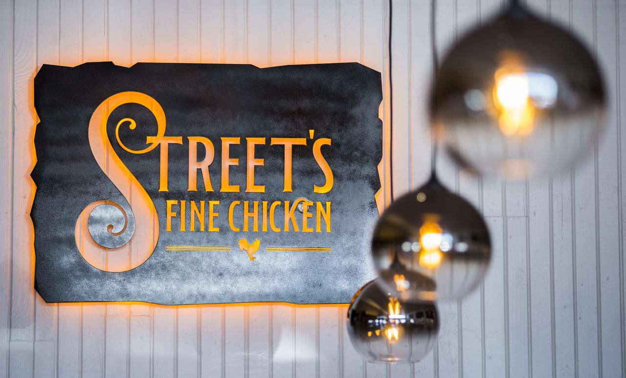 The sign over the bar at Street's Fine Chicken.