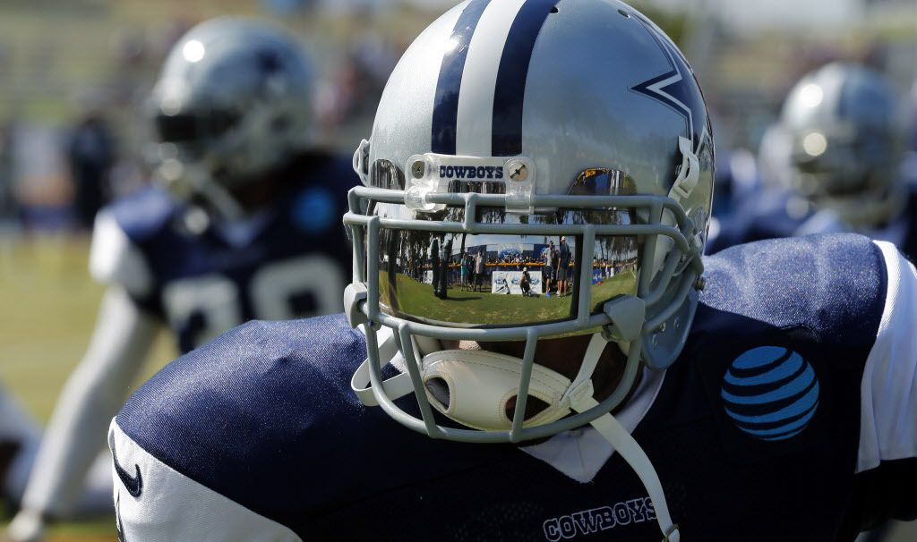 The Dallas Cowboys fans along the fence are reflected in cornerback Orlando Scandrick's face shield as the team stretched before afternoon practice at training camp in Oxnard, California, Thursday, August 4, 2016. (Tom Fox/The Dallas Morning News)