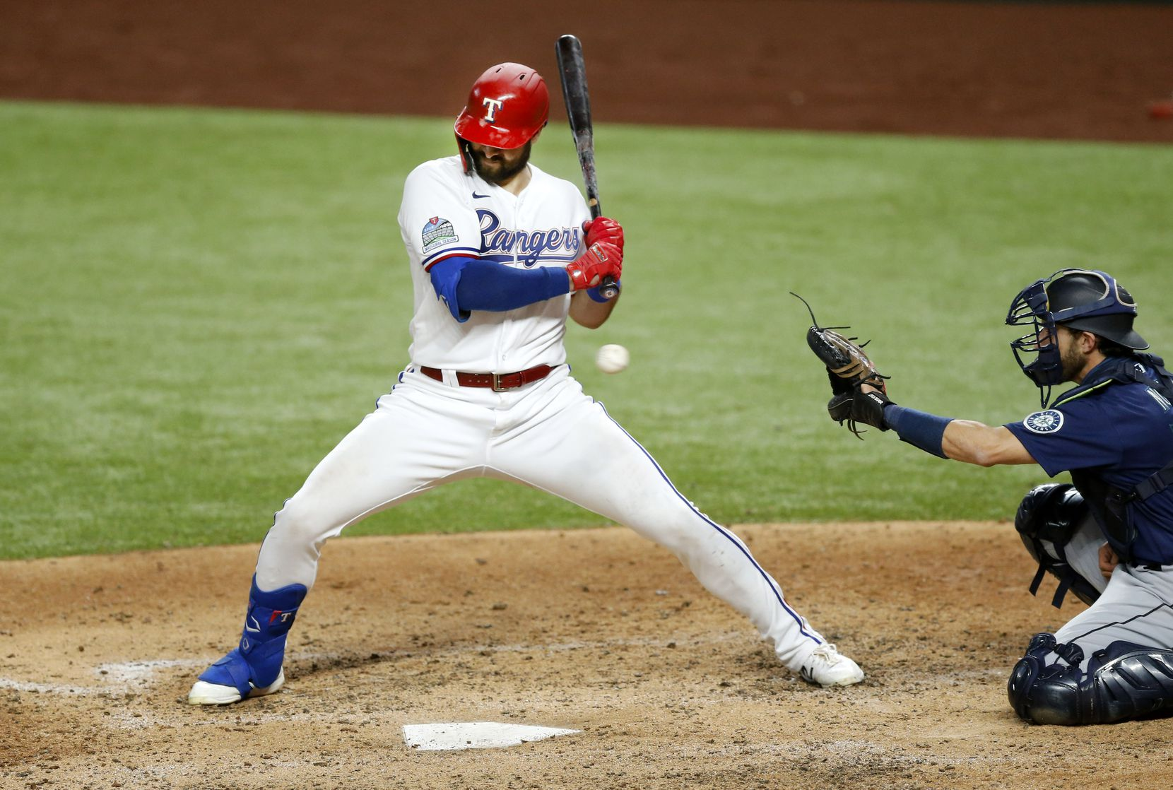 Texas Rangers center fielder Joey Gallo (13) leans back from an inside pitch by Seattle Mariners starting pitcher Marco Gonzales (7) in the fifth inning at Globe Life Field in Arlington, Tuesday, August 11, 2020. The pitch drew walk.