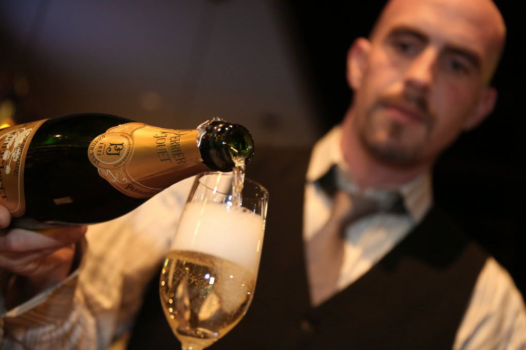 Pablo Taboada pours champagne at Max's Wine Dive in Dallas November 13, 2012. (Nathan Hunsinger/ Staff Photographer)
