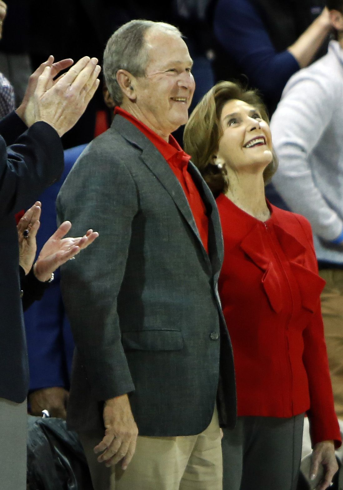 Former president George Bush and his wife Laura beam as they are announced to a welcoming crowd during the first half of the SMU versus Memphis game. SMU defeated memphis 58-53. The two teams from the NCAA's American Athletic Conference played their men's basketball game at SMU's Moody Coliseum in Dallas on February 25, 2020.