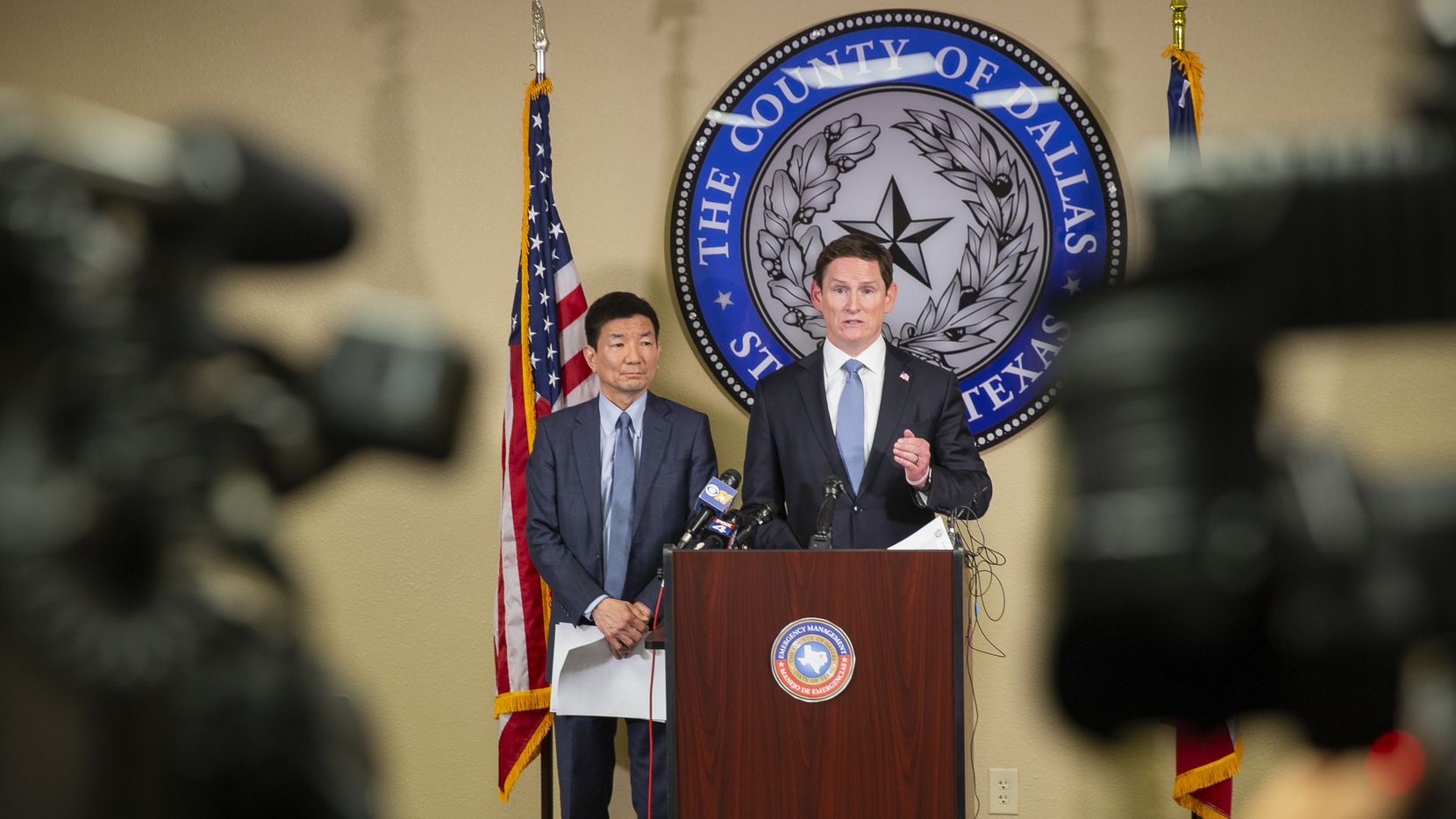 Dallas County Judge Clay Jenkins (right) and Dr. Philip Huang, Director of Dallas County Health and Human Services, ordered bars and restaurants to shut down throughout the area to help stem the new coronavirus at a press conference on March 16, 2020 in Dallas.