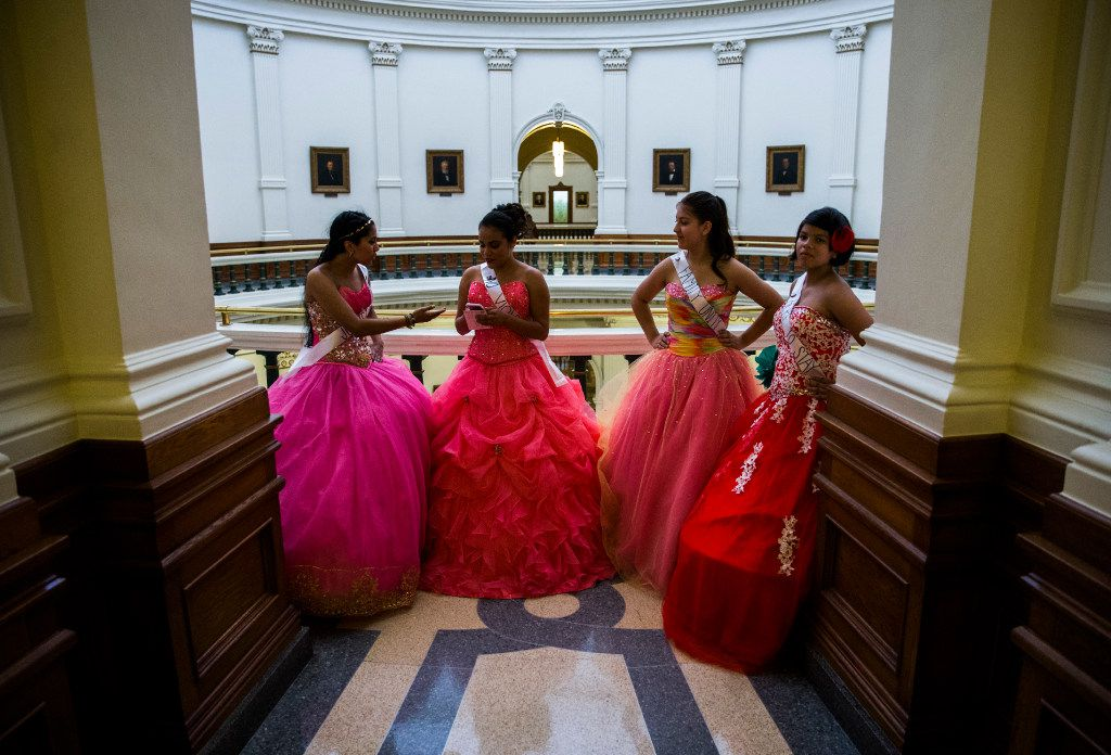 Leslie Abraham, Alesandra Lopez, Julia Pierce and Isabel Pierce wait to enter a senator's office to thank her for her opposition to SB 4 at the Texas Capitol in Austin.