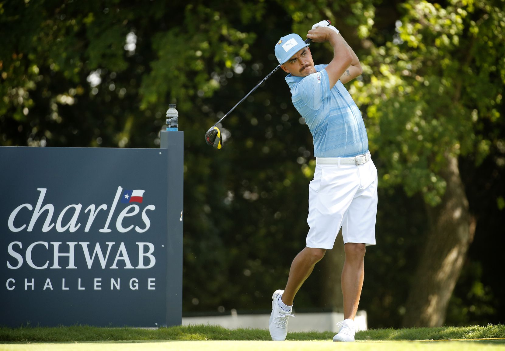 PGA golfer Rickie Fowler tees off on No. 9 during the Charles Schwab Challenge practice round at the Colonial Country Club in Fort Worth, Texas on Tuesday, June 9, 2020. The Challenge is the first tour event since the COVID-19 pandemic began.