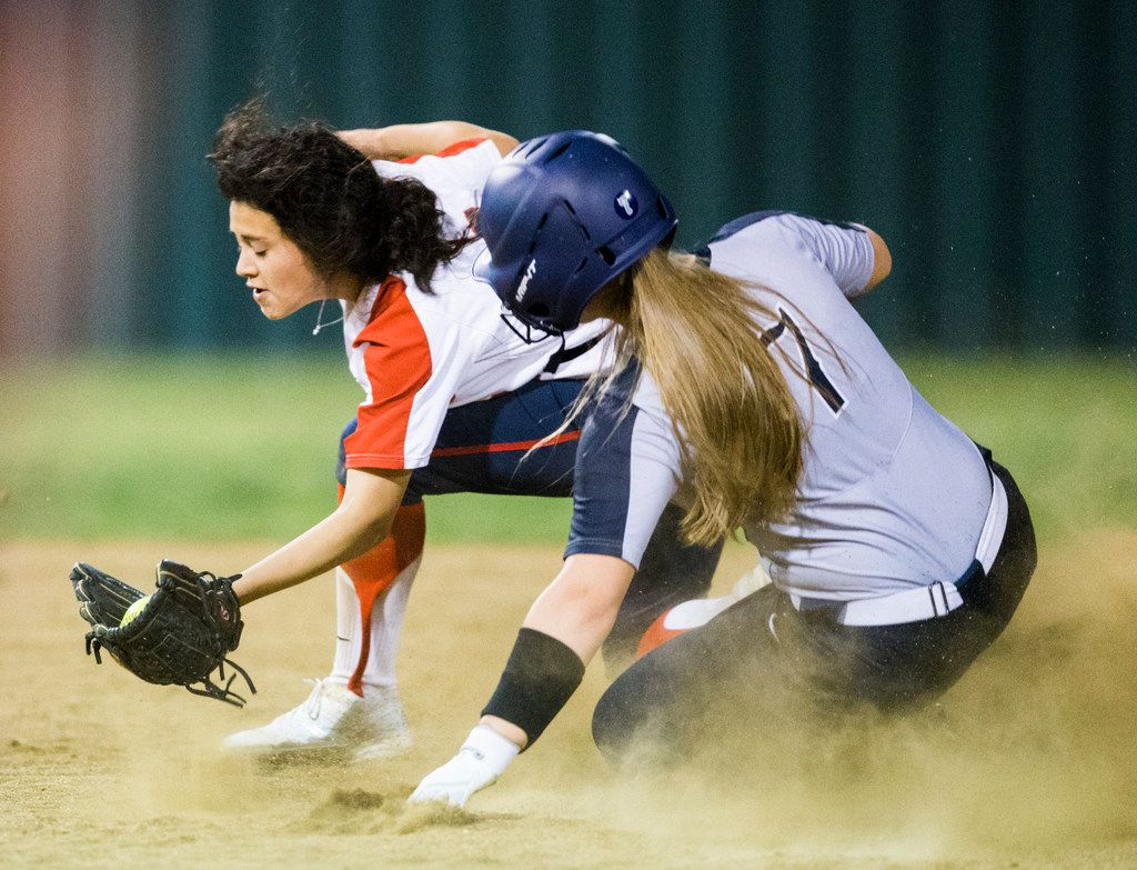 Frisco Lone Star's Hayley Peterson (7) makes it safely to second base ahead of Frisco Centennial's Daniela Arellanes during the fifth inning of Lone Star's 9-6 win. (Ashley Landis/The Dallas Morning News)
