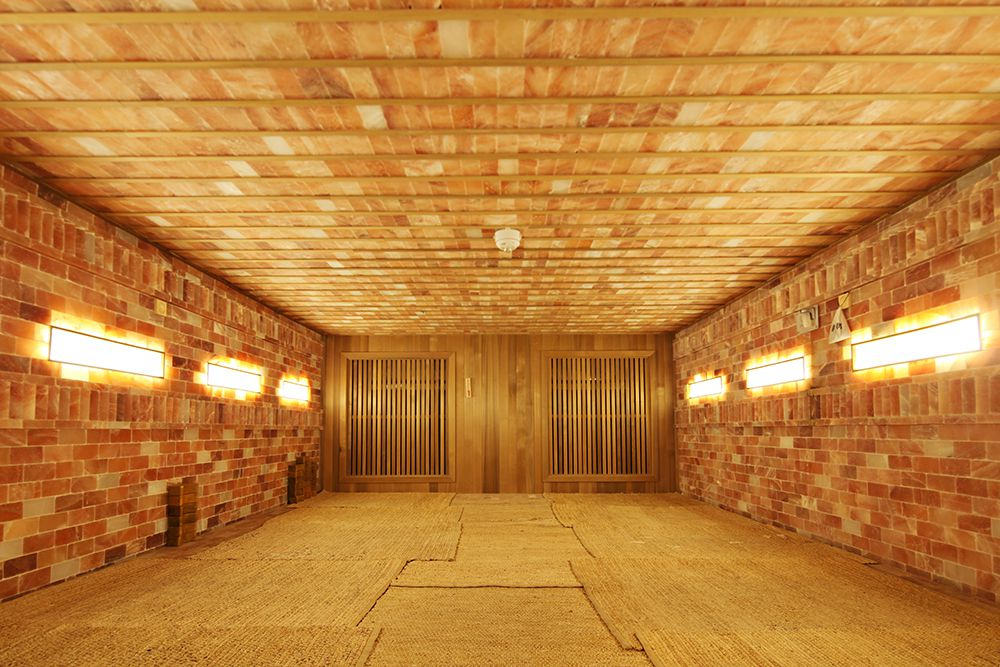 Spa Castle's new Sauna Yoga classes take place in its Himalayan Salt sauna. The room is typically 133 degrees and the lights are much more dim.