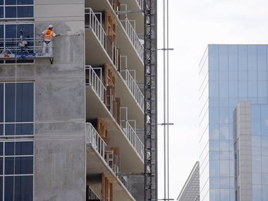 Construction continues at The Victor, an apartment tower next to American Airlines Center in Victory Park.