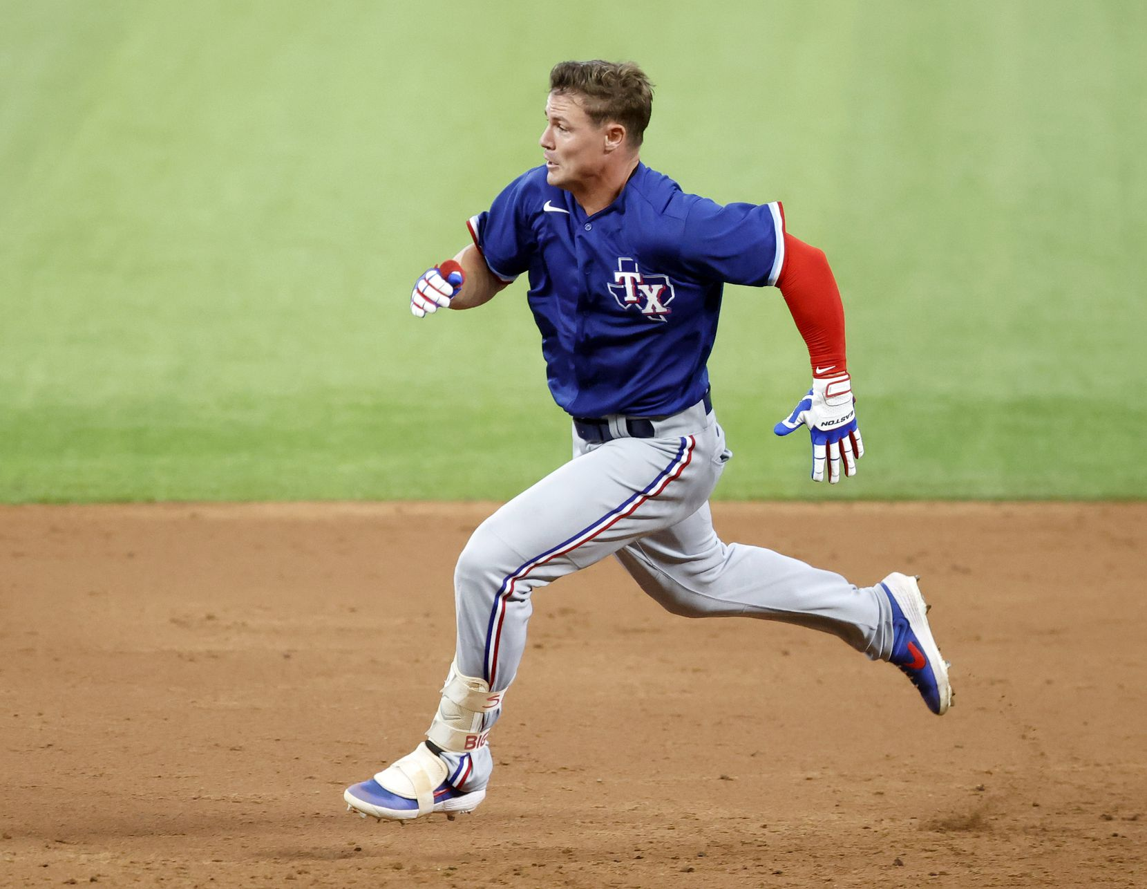 Texas Rangers outfielder Scott Heineman races to third on a triple during a simulated Summer Camp game at Globe Life Field in Arlington, Texas, Thursday, July 9, 2020. (Tom Fox/The Dallas Morning News)