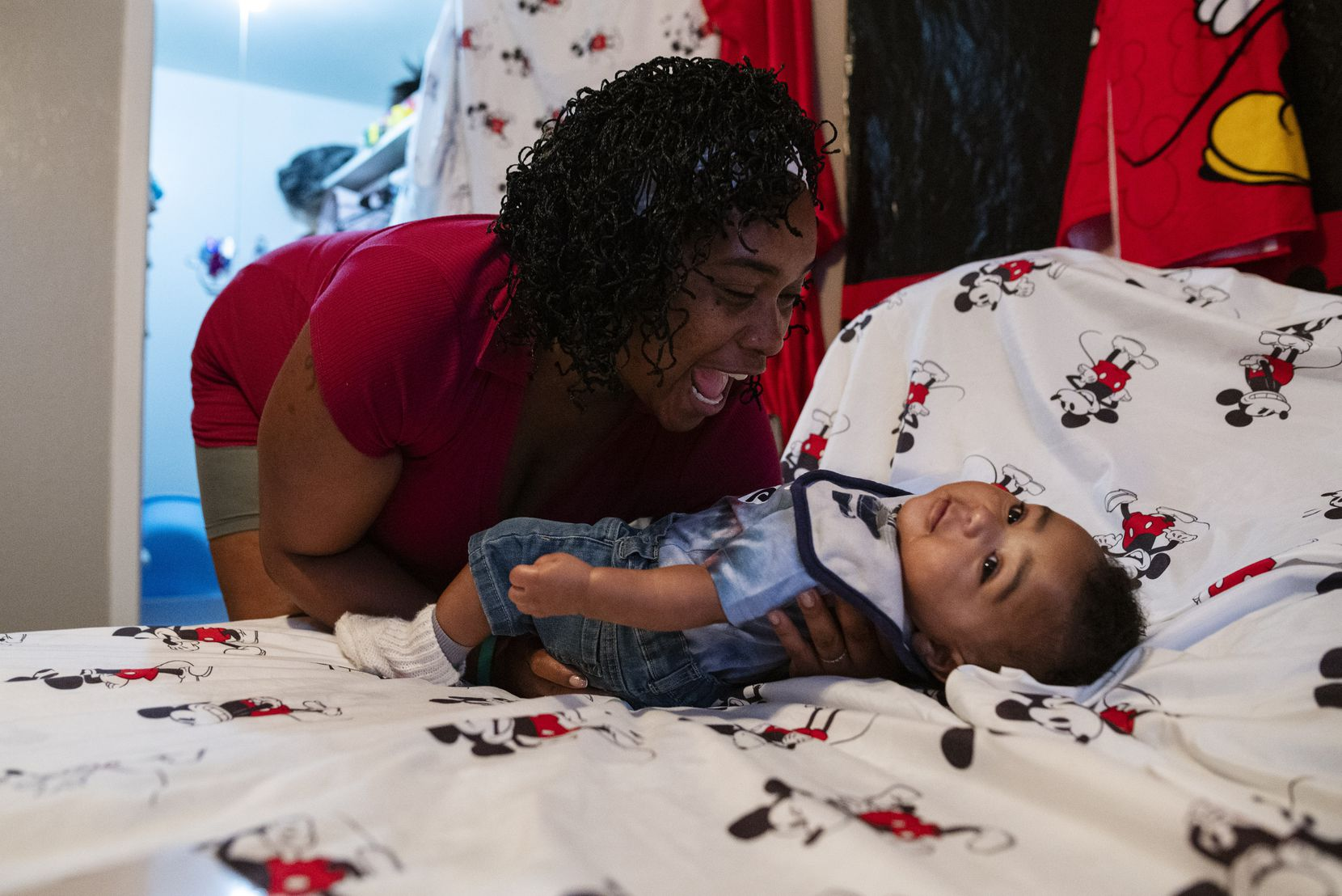 Roshell Johnson, 36, interacts with her baby Masiah Johnson after he woke up from a nap at her home in Dallas, Johnson is a former homeless resident who moved into a new Dallas apartment with her baby this month with the help of Family Gateway, a homelessness and housing service provider.