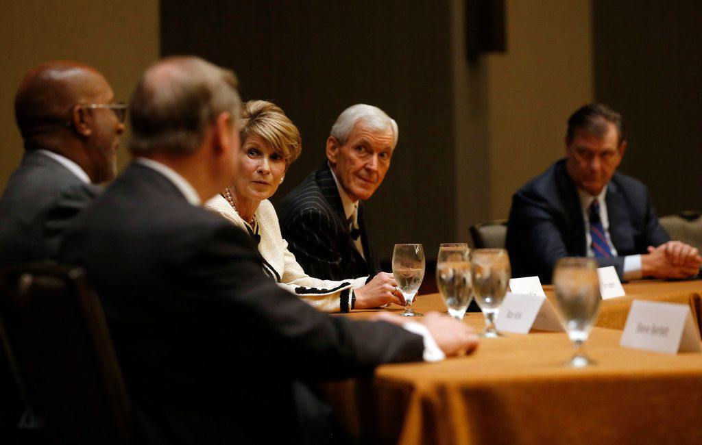 Former Dallas Mayor Ron Kirk (left) talks as former mayors (from left) Steve Bartlett), Laura Miller and Tom Leppert and current Mayor Mike Rawlings listen during a panel held by the Dallas Friday Group at the Hyatt Regency in Dallas on Friday, October 12, 2018.