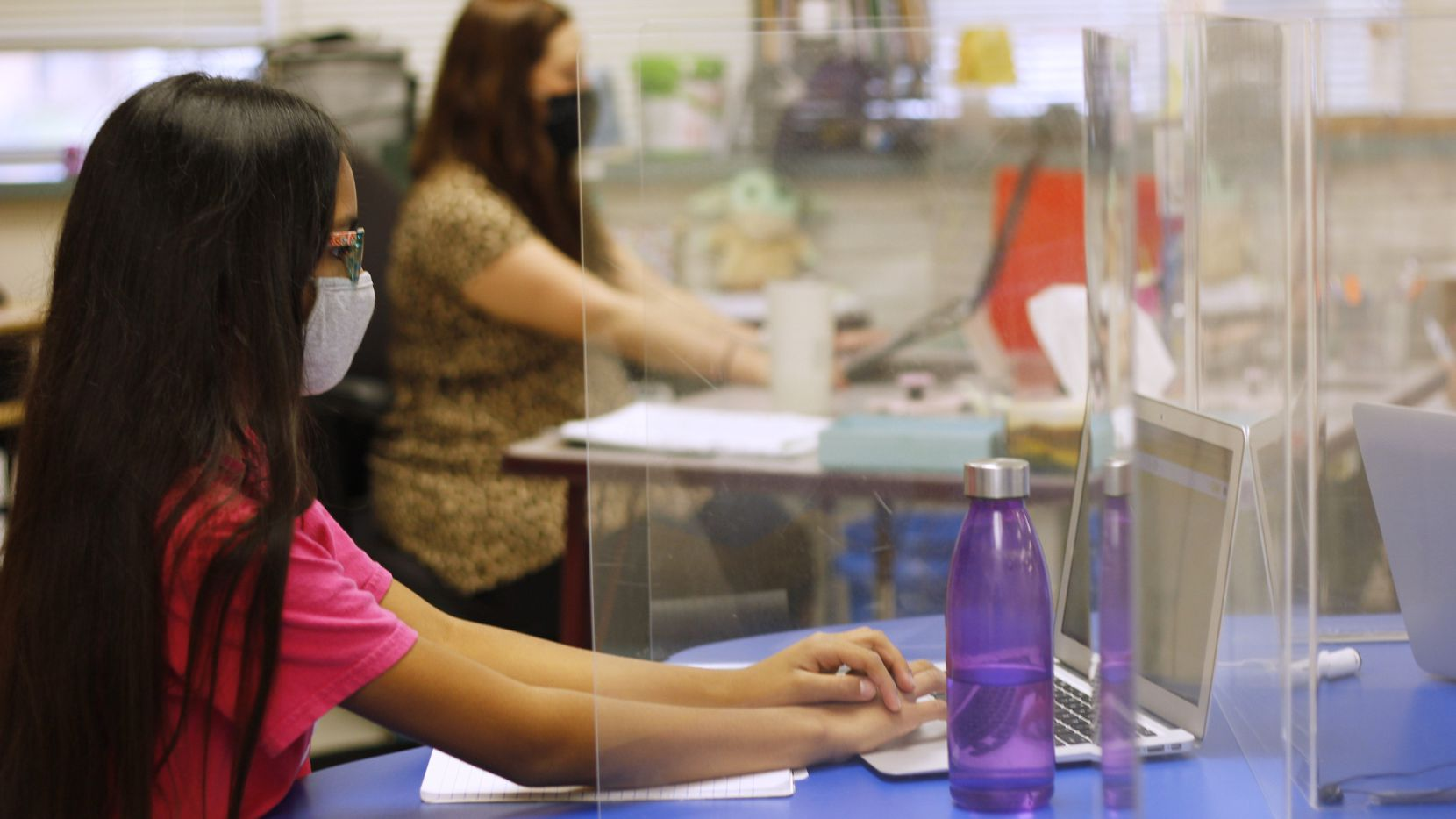 One of the challenges with creating a yearbook during the pandemic was the lack of photos available, Diaz said. But even the shots of masks and Plexiglass  of students in Garland ISD's Beaver Technology Center will be worth remembering some day, she said. (Courtesy Tevis Diaz)