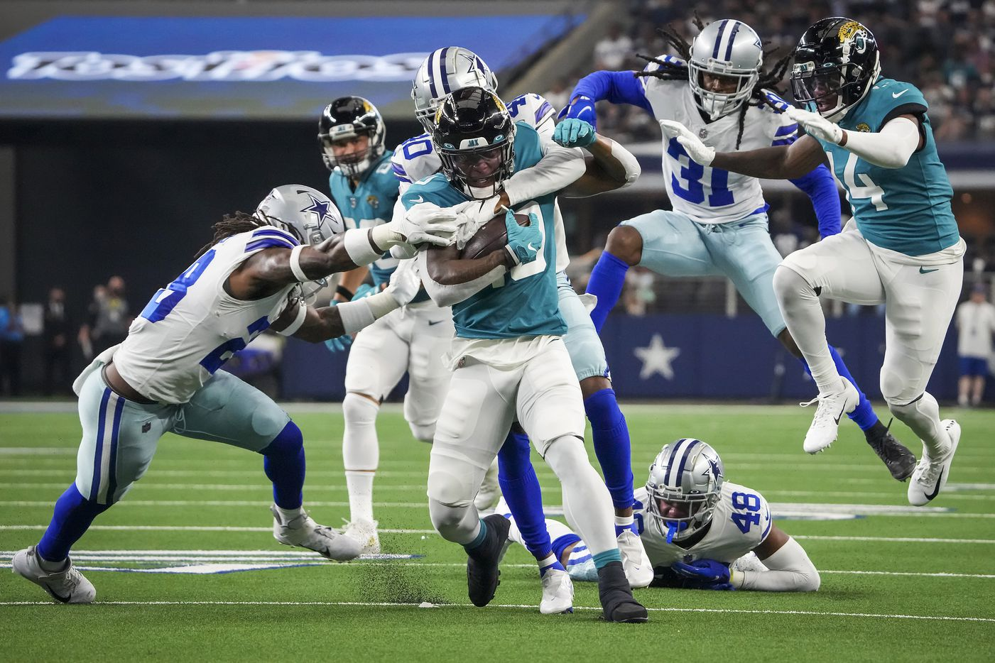 Jacksonville Jaguars wide receiver Laviska Shenault Jr. (10) is brought down by Dallas Cowboys free safety Malik Hooker (28) and cornerback Nahshon Wright (40) as linebacker Jabril Cox (48) and cornerback Maurice Canady (31) trail on the play during the first half of a preseason NFL football game at AT&T Stadium on Sunday, Aug. 29, 2021, in Arlington. (Smiley N. Pool/The Dallas Morning News)