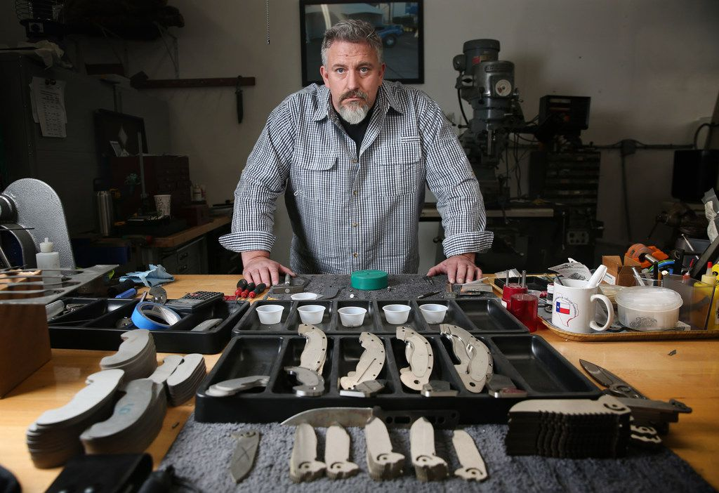 Todd Begg poses for a photograph at his shop where he crafts knives in Dallas.