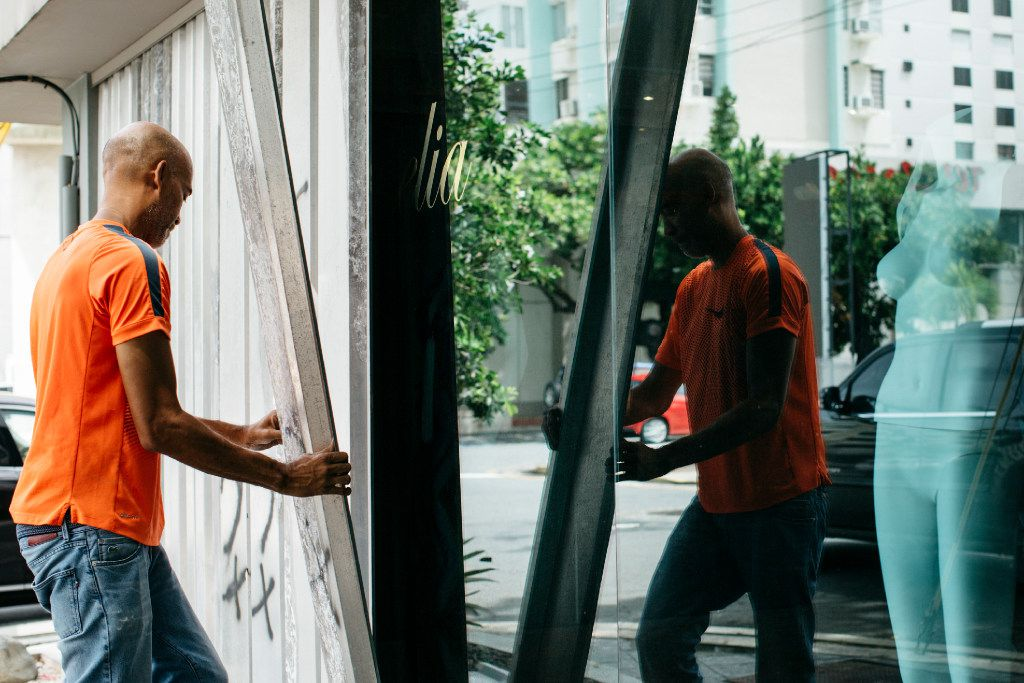 Ellis Cerda puts up storm shutters at a boutique in San Juan, Puerto Rico, on Wednesday.