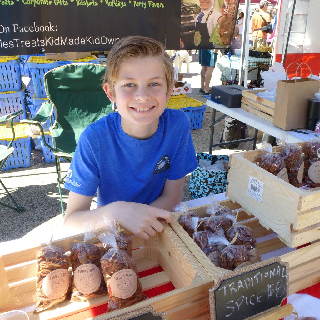 Charlie Kobdish was on hand at the Lakewood Village Farmers Market kick-off with kid-made Charlie's Treats flavored pecans.