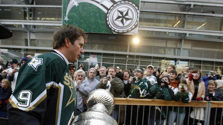 2007 NHL All-Star Game, American Airlines Center in Dallas -- Mike Modano carries the Stanley Cup to the stage along the south plaza area outside American Airlines Center for a ceremony honoring the 1999 Stanley Cup Champion team.