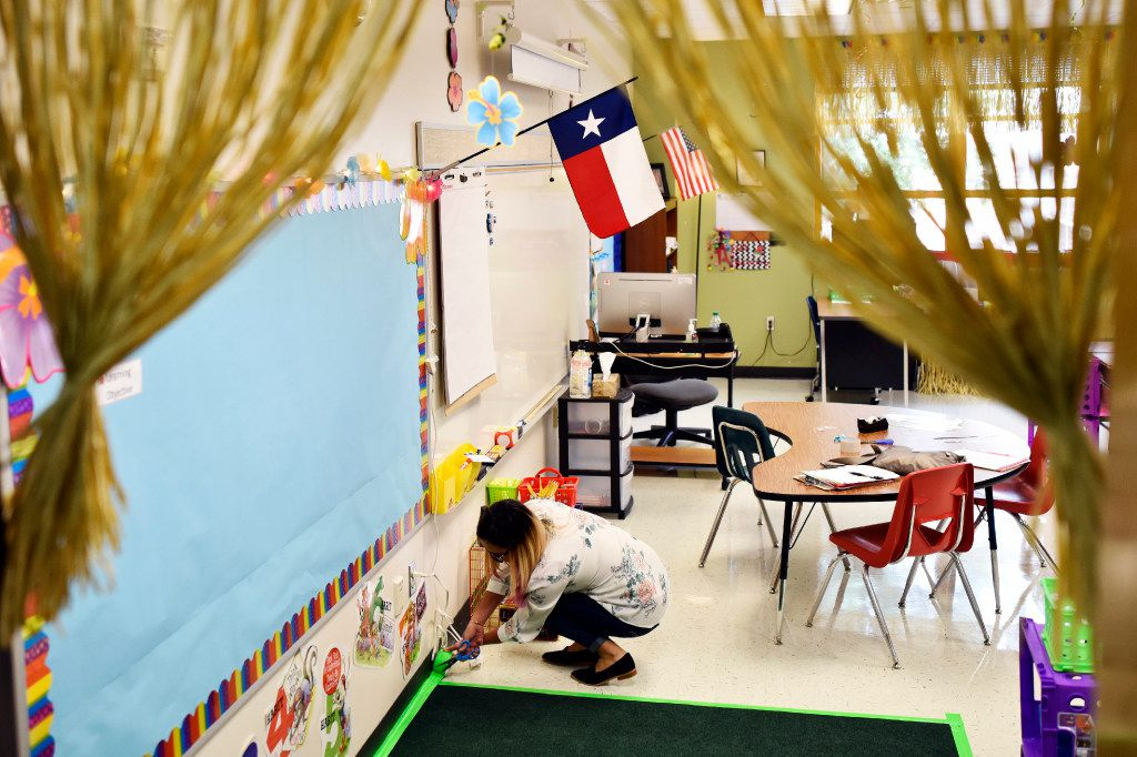 Bilingual teacher Maria Navarro worked last week to prepare her classroom for the first day of school at Jack Lowe Sr. Elementary in Dallas. (Ben Torres/Special Contributor)