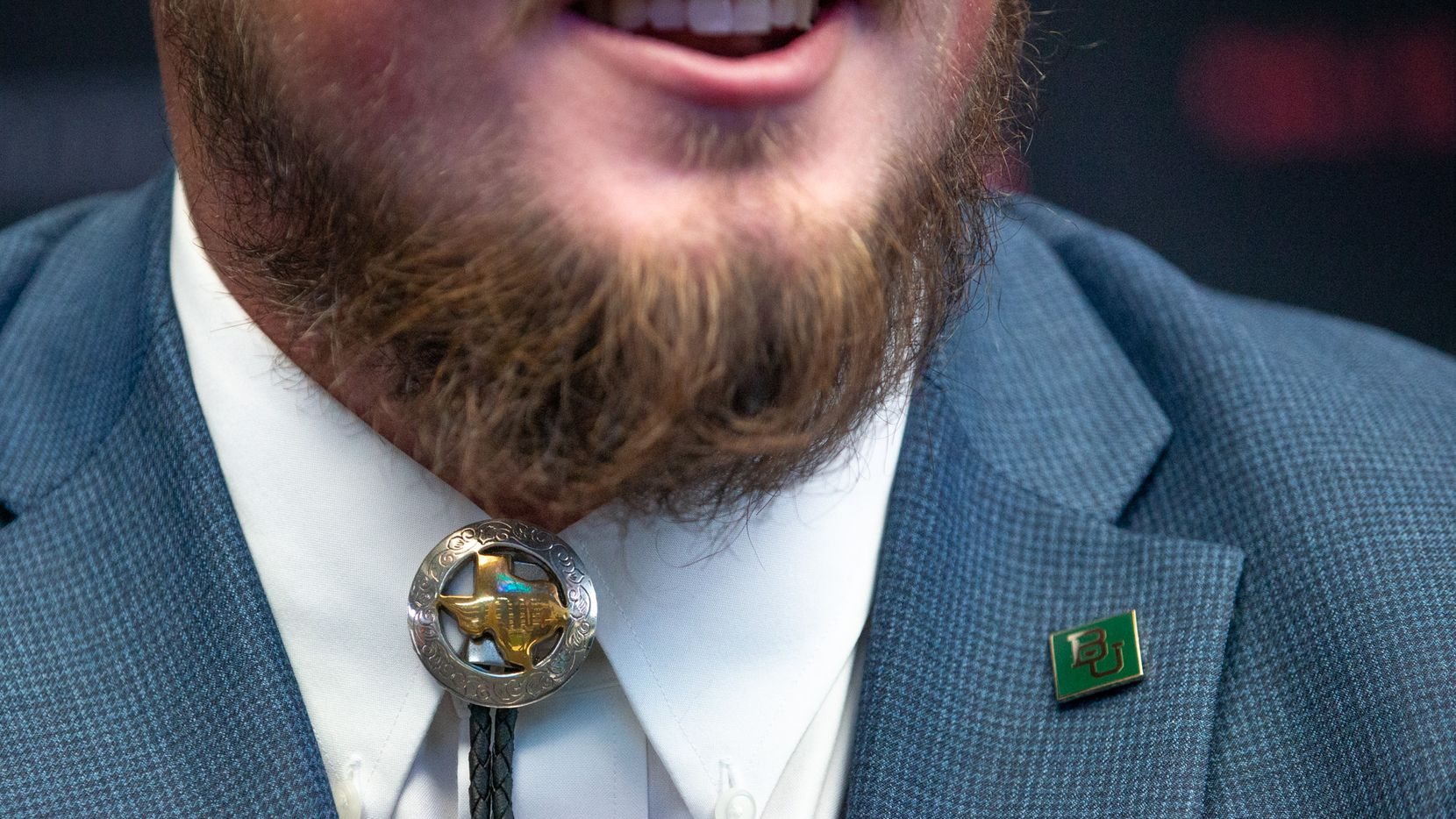 Sam Tecklenburg, an offensive lineman for Baylor, wears a bolo tie during the Big 12 Conference Media Days event at the AT&T Stadium in Arlington on July 16, 2019. He bought it on eBay for a few dollars after he saw a person wearing one at a wedding he attended last year, he said.