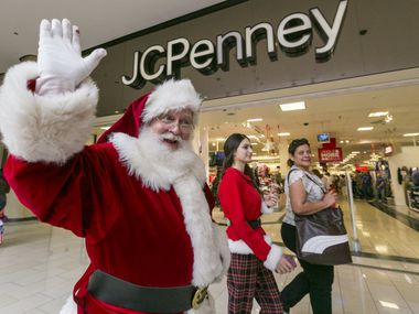 A man dressed as Santa Claus greeted shoppers a few years ago outside the J.C. Penney store in California. Penney's bankruptcy reorganization is bumping up against the all-important holiday shopping season.
