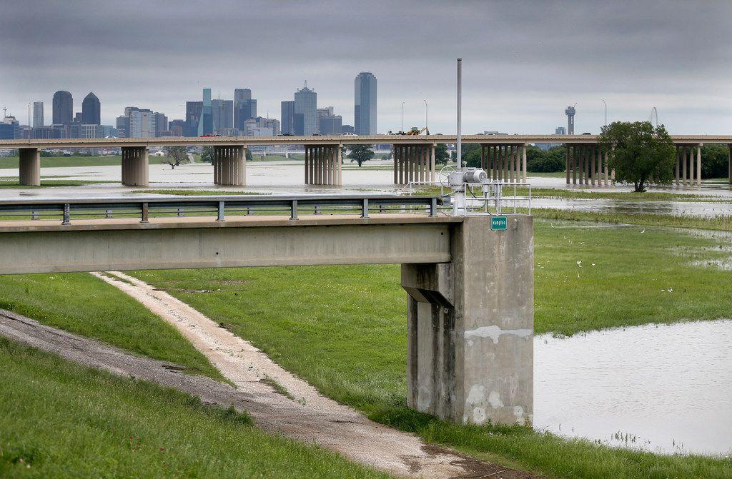 A day after flooding rains the Trinity River near the Hampton Pump Station was still plenty full.