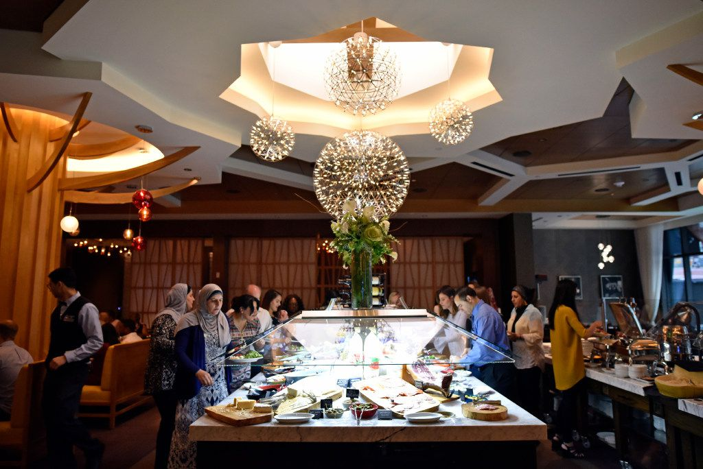 Diners gather around the market table to serve themselves a variety of foods including meats and fruits inside the new Fogo de Ch‹o in Uptown, Friday, May 19, 2017 in Dallas. Ben Torres/Special Contributor