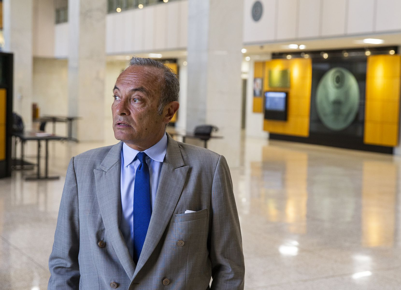 Attorney Fernando Dubove surveys the entrance lobby of the nearly empty Earle Cabell Federal Building Thursday morning on March 26, 2020 in Dallas.