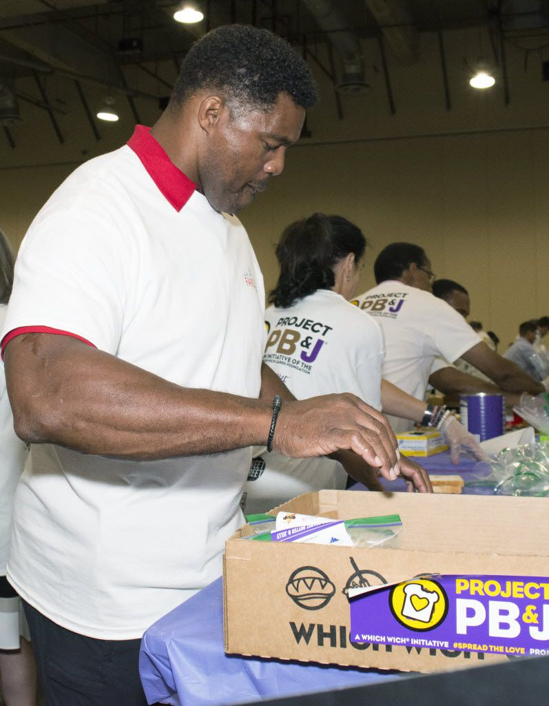 Former NFL player Herschel Walker boxes up PB&J sandwiches towards the end of Which Wich's one hour Guinness World Record Spreading Party that will help feed thousands of North Texans.