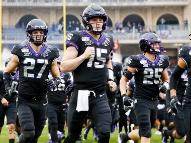 FILE - TCU quarterback Max Duggan (15) leads his team onto the field to face West Virginia at Amon G. Carter Stadium in Fort Worth on Friday, Nov. 29, 2019.