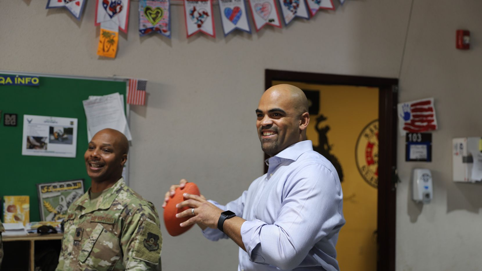 Rep. Colin Allred, D-Dallas, throws a football at Camp Arifjan in Kuwait. Allred visited the base as part of a weeklong trip to visit soldiers in Kuwait and Afghanistan late last year.