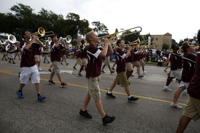 A marching band performs during the Garland Labor Day Parade.